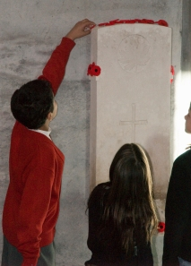 View of Children placing poppies on the grave stone of the Unknown soldier